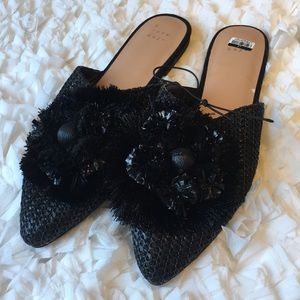 A New Day slippers with black flowery decoration